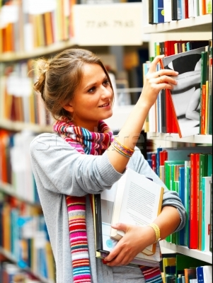 43554 stock-photo-female-university-student-selecting-book-from-shelf-in-a-library
